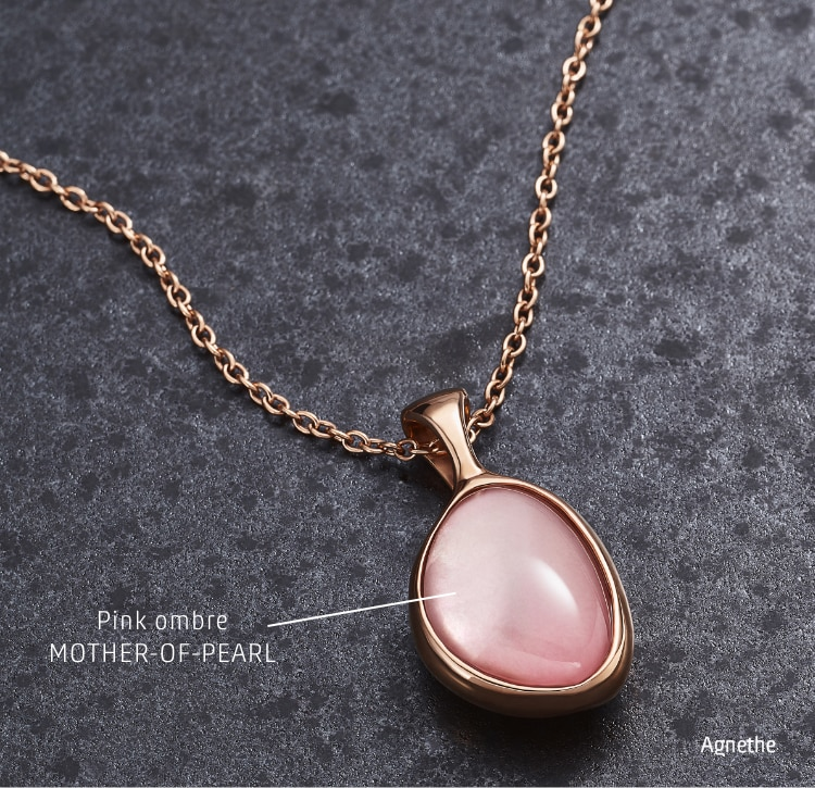 Image of  gold-tone necklace with a pink mother-of-pearl pendant. Callout: Pink ombre MOTHER-OF-PEARL