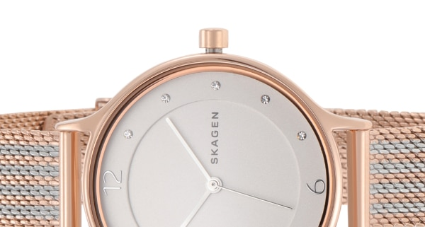 a rose gold skagen watch with a mesh band