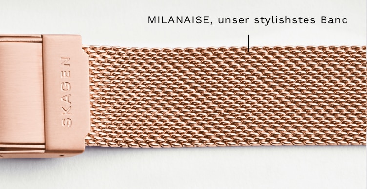A close-up of a rose gold mesh strap. Callout: MESH, our style-defining strap
