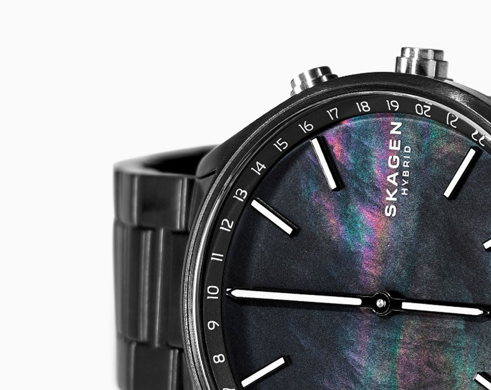 A Holst hybrid smartwatch with a black case and strap, and mother-of-pearl dial.