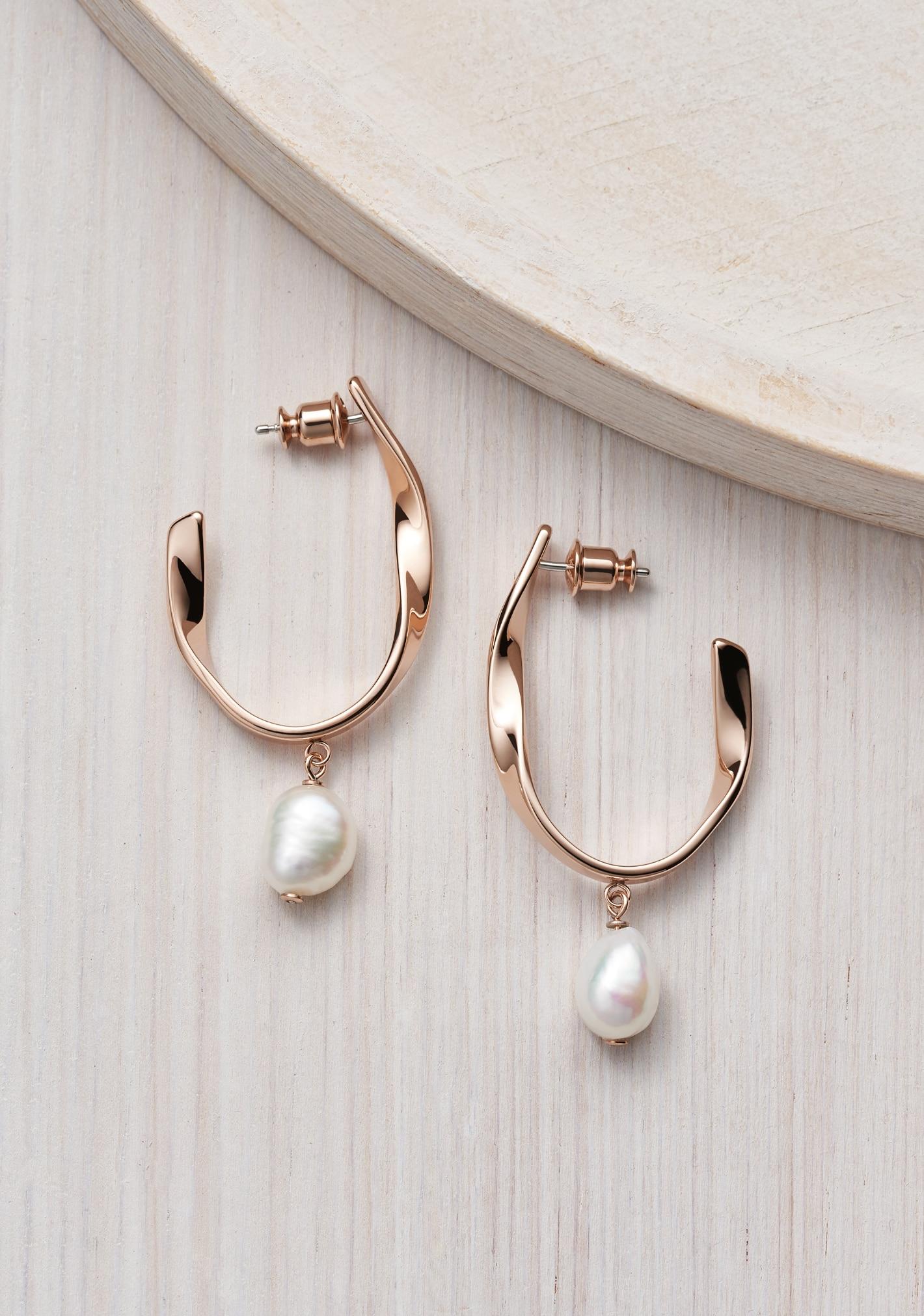 two skagen earrings with pearls