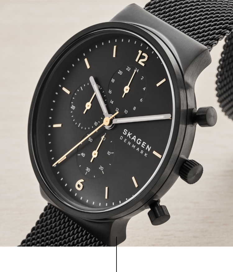 Black watch with gold-tones on the indexes.