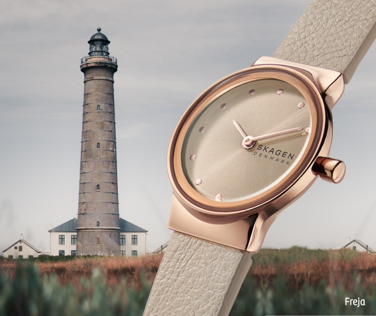 Image of watch next to a lighthouse.
