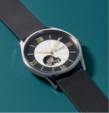 Silver case with a black and white dial and black leather strap.
