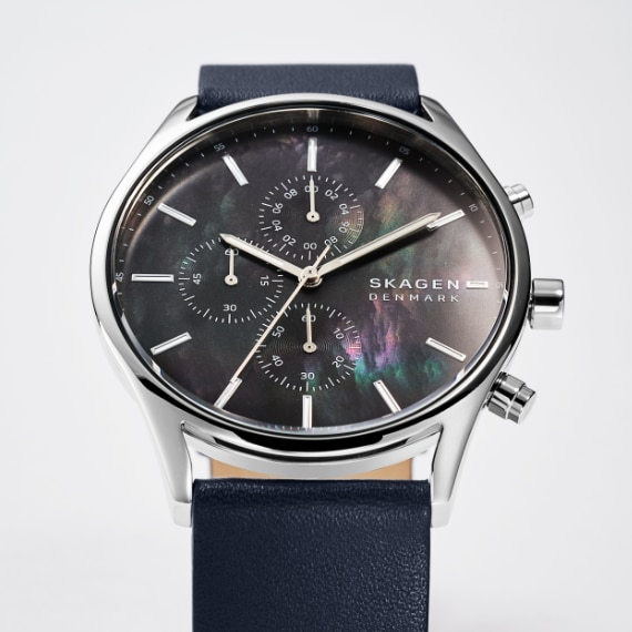 a black Skagen watch with a mother of pearl face and a black leather strap