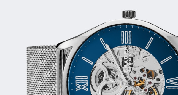 Silver-tone case with matching mesh strap and a blue dial.