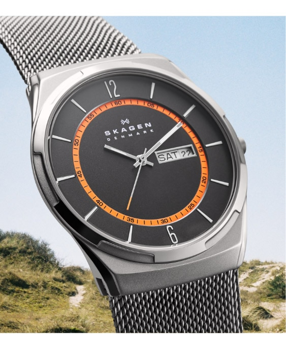 Silver-tone case with matching mesh strap with black dial and orange inner ring.