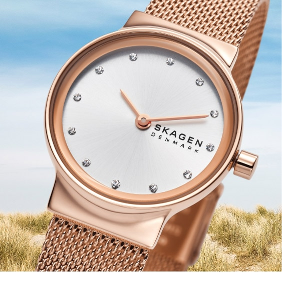Rose gold-tone case and matching mesh strap with a white dial and sparkling indexes.