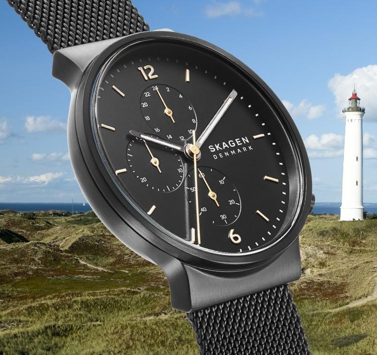 Black watch next to a lighthouse.