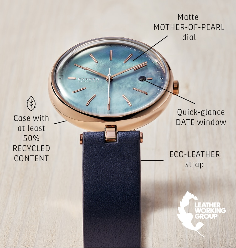 a Skagen solar watch with the following callouts: Case with at least 50% RECYCLED STAINLESS STEEL. ECO-LEATHER strap. Matt MOTHER-OF-PEARL dial. Quick-glance DATE window.