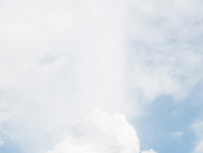 blue decorative background with fluffy white clouds