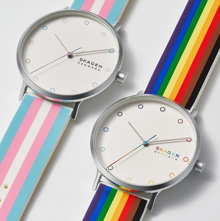a pair of skagen pride watches with the rainflag and the transgender flag