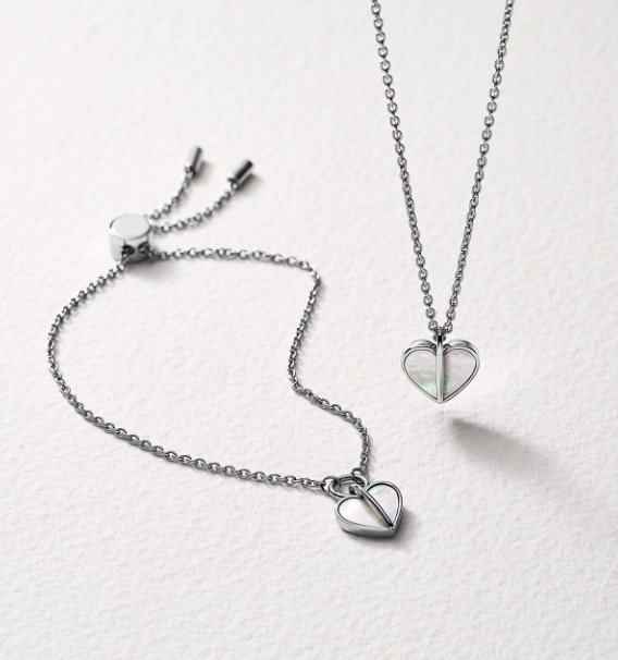 Silver-tone jewelry with matching pendants with mother-of-pearl.
