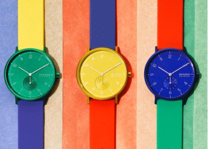 three aaren color blocked watches on a striped background