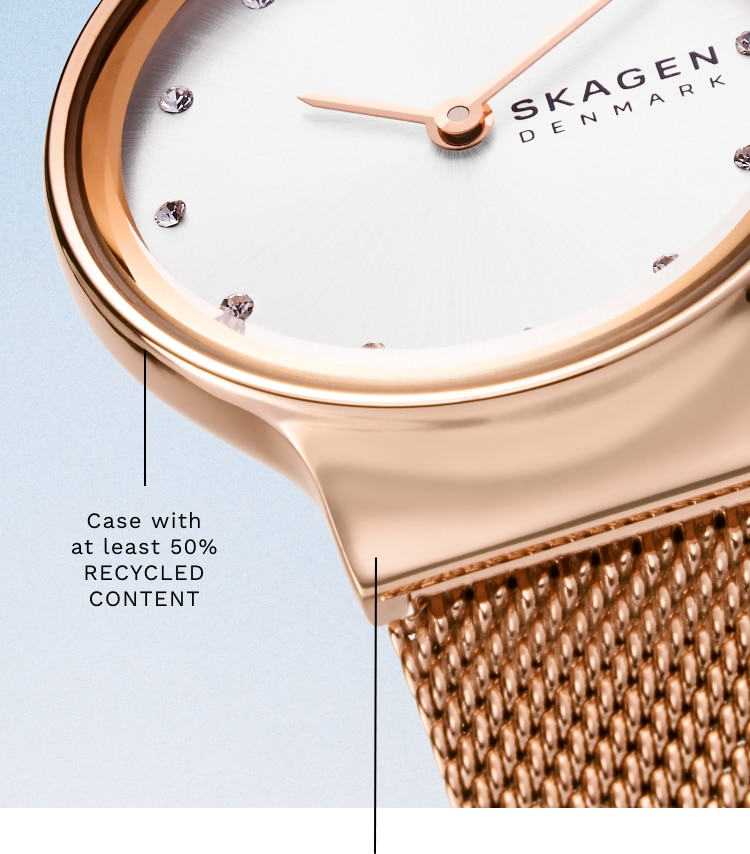 A close-up of the hooded lug of the Skagen freja watch. Callout: Case with at least 50% RECYCLED CONTENT