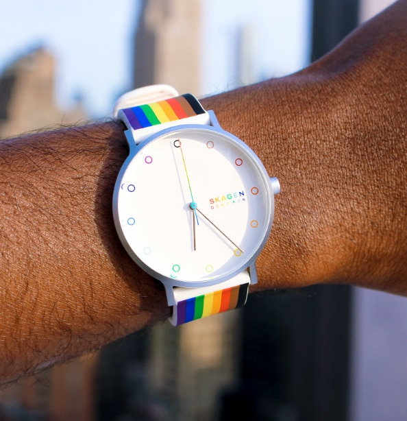 Image of a wrist wearing our rainbow Pride watch.