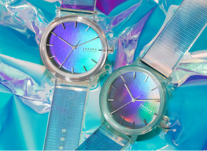 a pair of aaren iridiscent watches