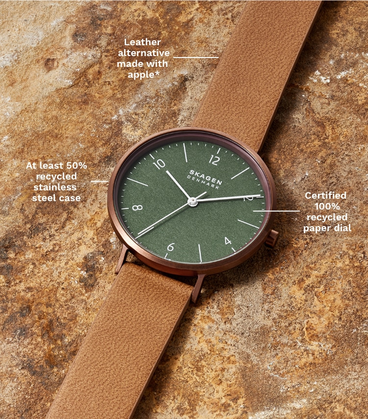 A brown tone watch with a green dial that's pro-planet.