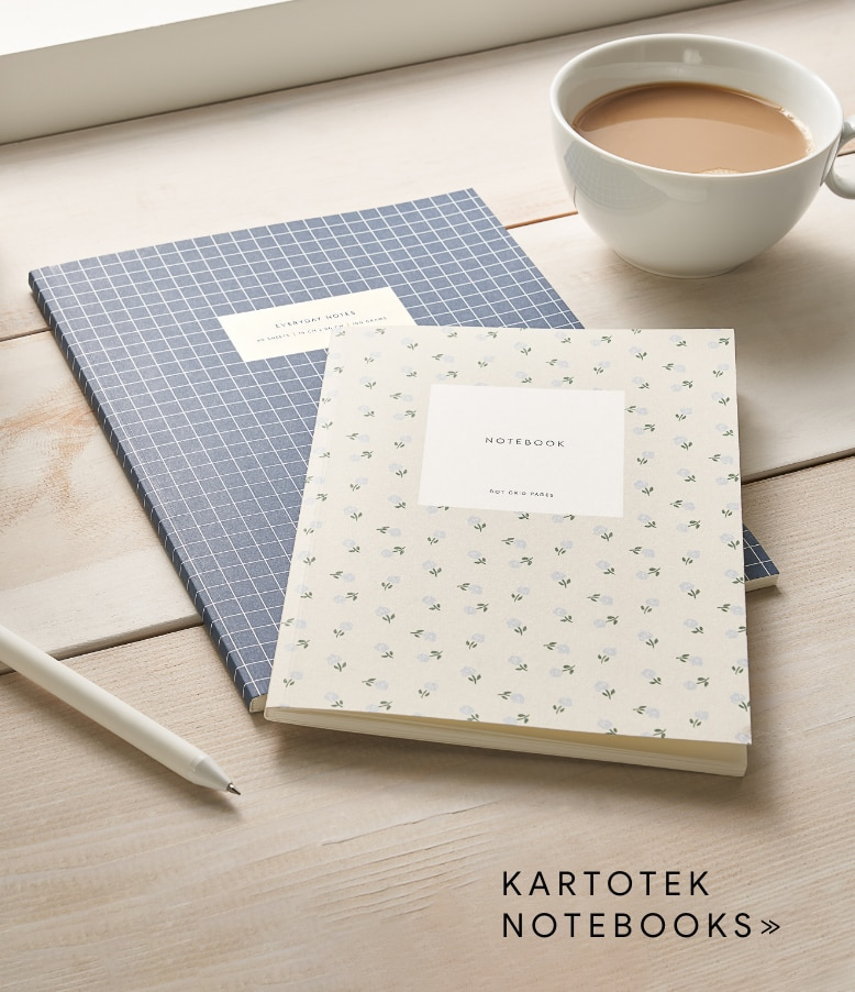 a pair of kartotek notebooks