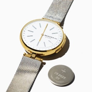 A Holst hybrid smartwatch with black case and strap, and mother-of-pearl dial.