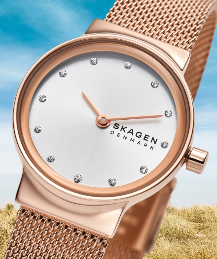 A Skagen Freja watch in rose gold with a blue sky background